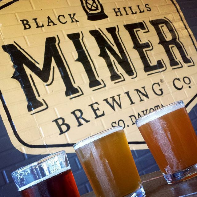Armed with a taste for adventure and thirst for good beer, I jumped in the car with Island Boy and plugged the Black Hills into the GPS. Leaving the familiar craft beer mecca of Minnesota for the uncharted #SouthDakota beer landscape was a little nerve racking, but our thirst was soon quenched. While the quality of beer in the Black Hills is above average as a whole, @minerbrewingcompany was definitely a standout.  Featured here is Miner's Red, White + Blue flight celebrating Independence Day, which consisted of an Irish Red Ale, a White IPA and a Blue IPA.  If you're a craft beer lover and find yourself in the Black Hills area, be sure to grab a pint at Miner Brewing, and for my full review of Miner Brewing, visit kohleen.yelp.com!  #HiFromSD #craftbeer #SoDakSummer #beercation #beertravel #SoDakCraftBeer #blackhillsbeer #minerbrewing #TheMidwestival