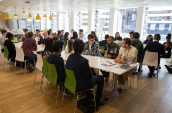 Saajan and other Zendesk employees providing guidance at a HeadStart workshop in our London office.