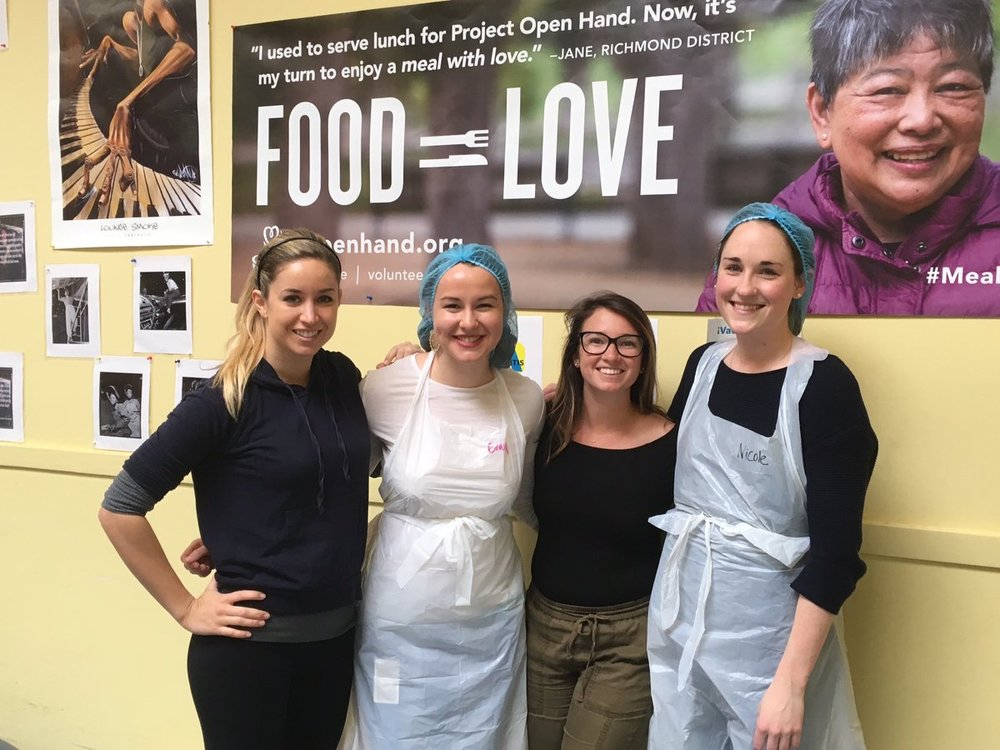 A group of four Zendesk employees volunteering at our non-profit partner,  Curry Senior Center,  in San Francisco.