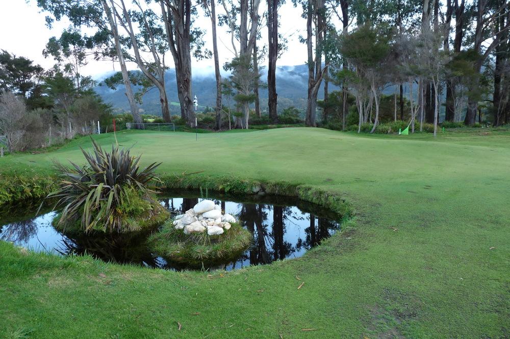 Hidden pond in front of green.jpg