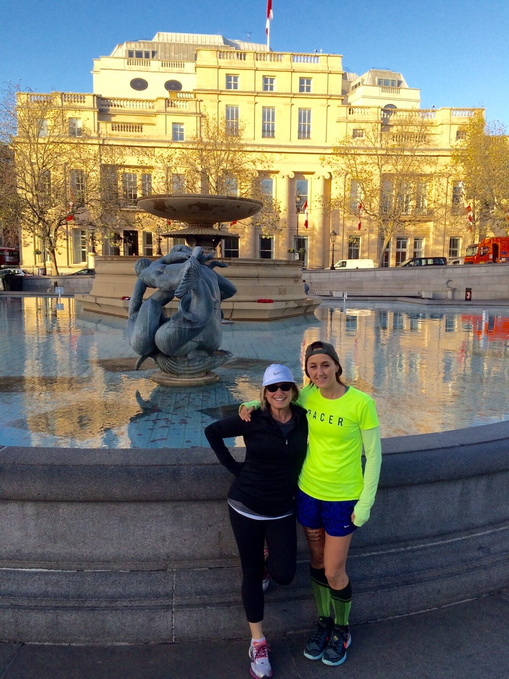 With Nike coach Maggie in Trafalgar Square. Still standing and smiling after my hamstring strain.