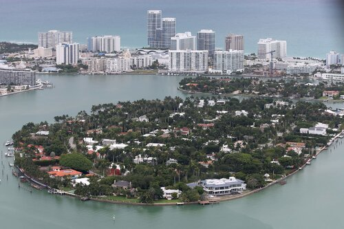 Florida cities like Miami are built on limestone are are at sea level. They are at great risk of flooding with rising sea levels.  Image borrowed from  Business Insider .