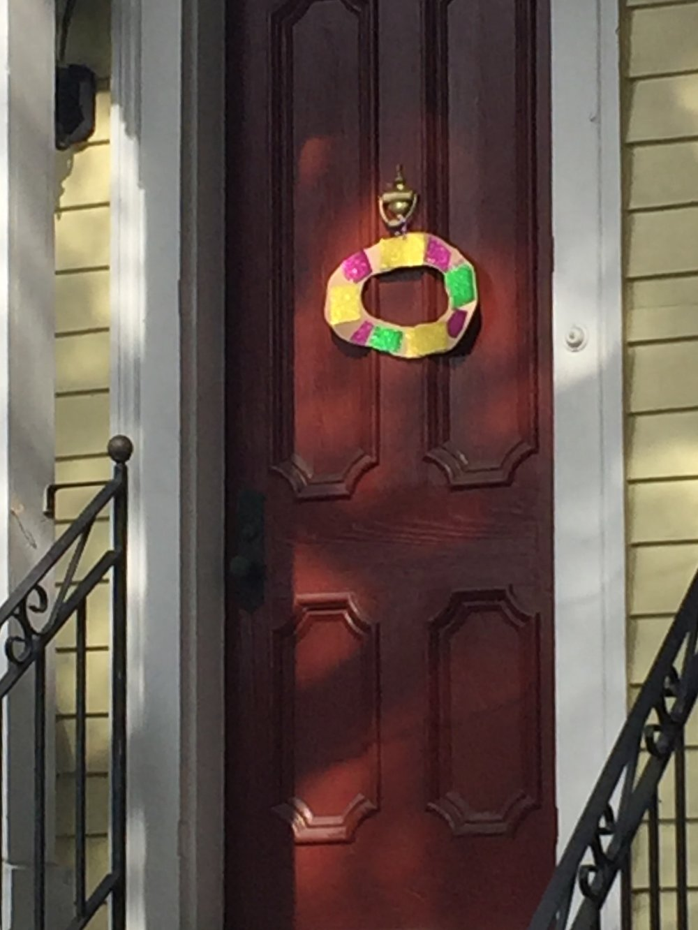 Sign of the season --  king cake wreaths on New Orleans doors