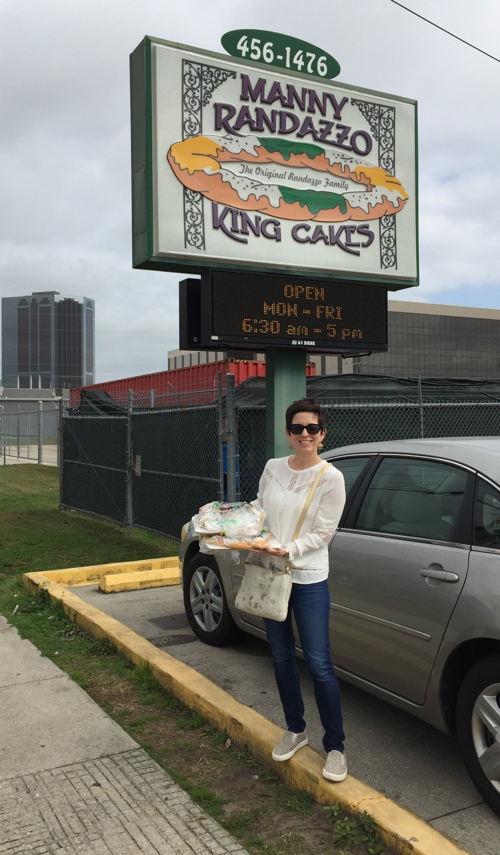 First stop and a perennial favorite! Michelle ready to roll with king cake in hand.