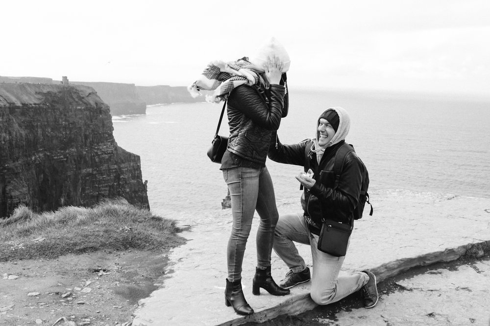 Couple proposes on the Cliffs of Moher in Ireland