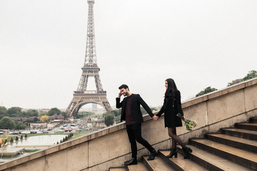 Parisian couple on the Trocadero steps in front of the Eiffel Tower with Wedding Photographer