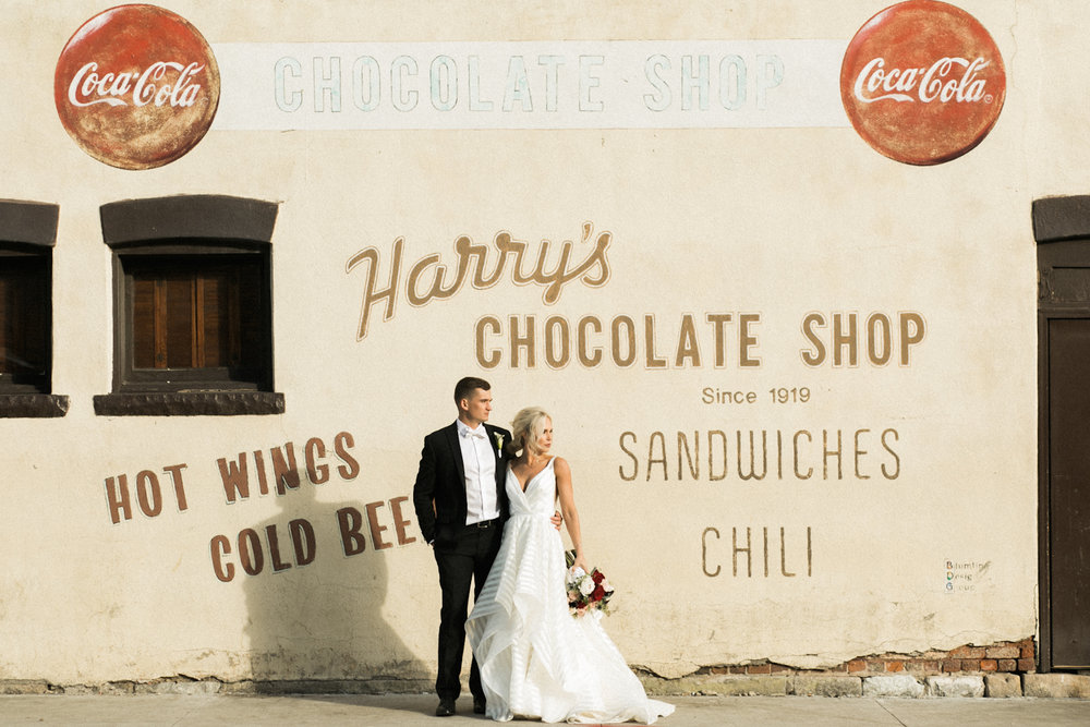 Wedding Photographer captures bride and groom at Harry's Chocolate Shop in West Lafayette, Indiana