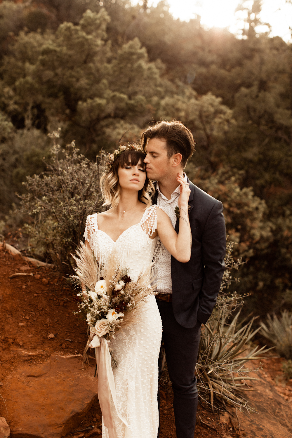 Couple embraces in Sedona Arizona intimate wedding picture.