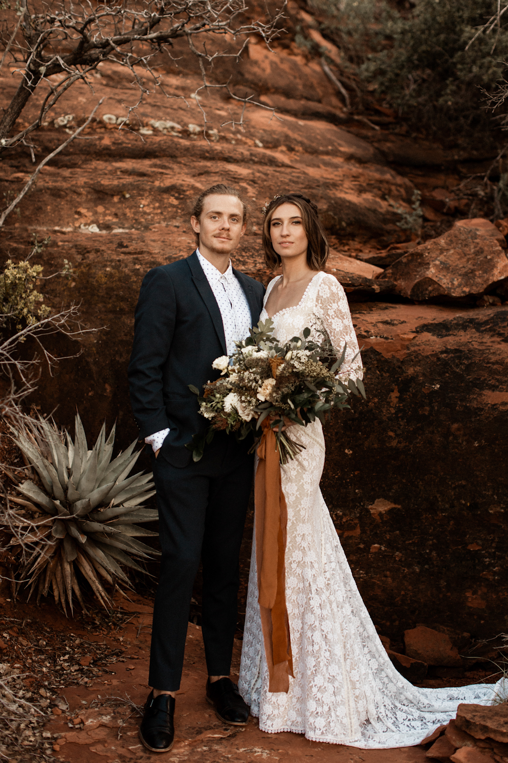 Couple poses for a wedding elopement portrait in Sedona, Arizona.