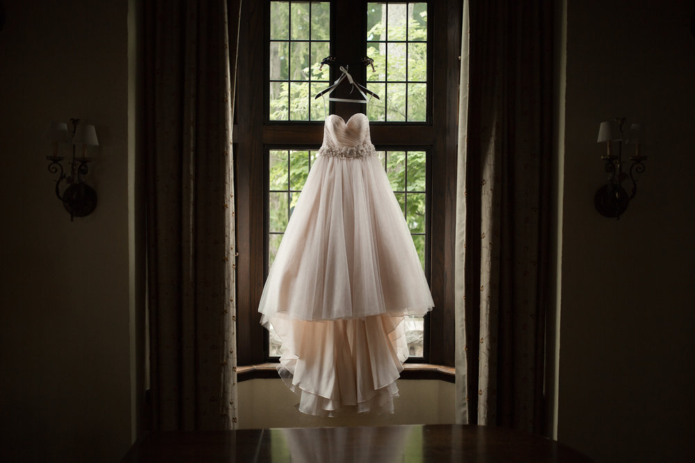Blush bridal ballgown hanging in window at Park Tudor in Indianapolis
