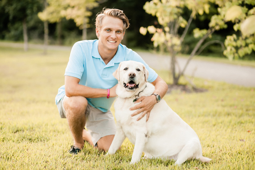 High School senior guy poses with his dog. Indiana Senior Photographer Cassie Howard