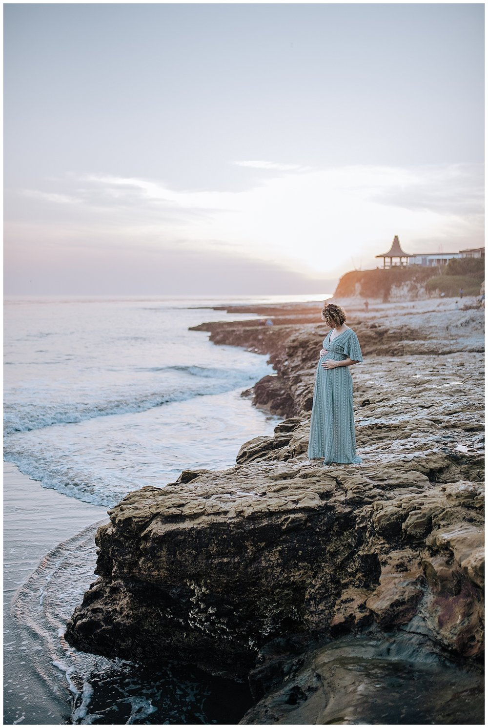 beach maternity session at sunset overlooking ocean in santa cruz