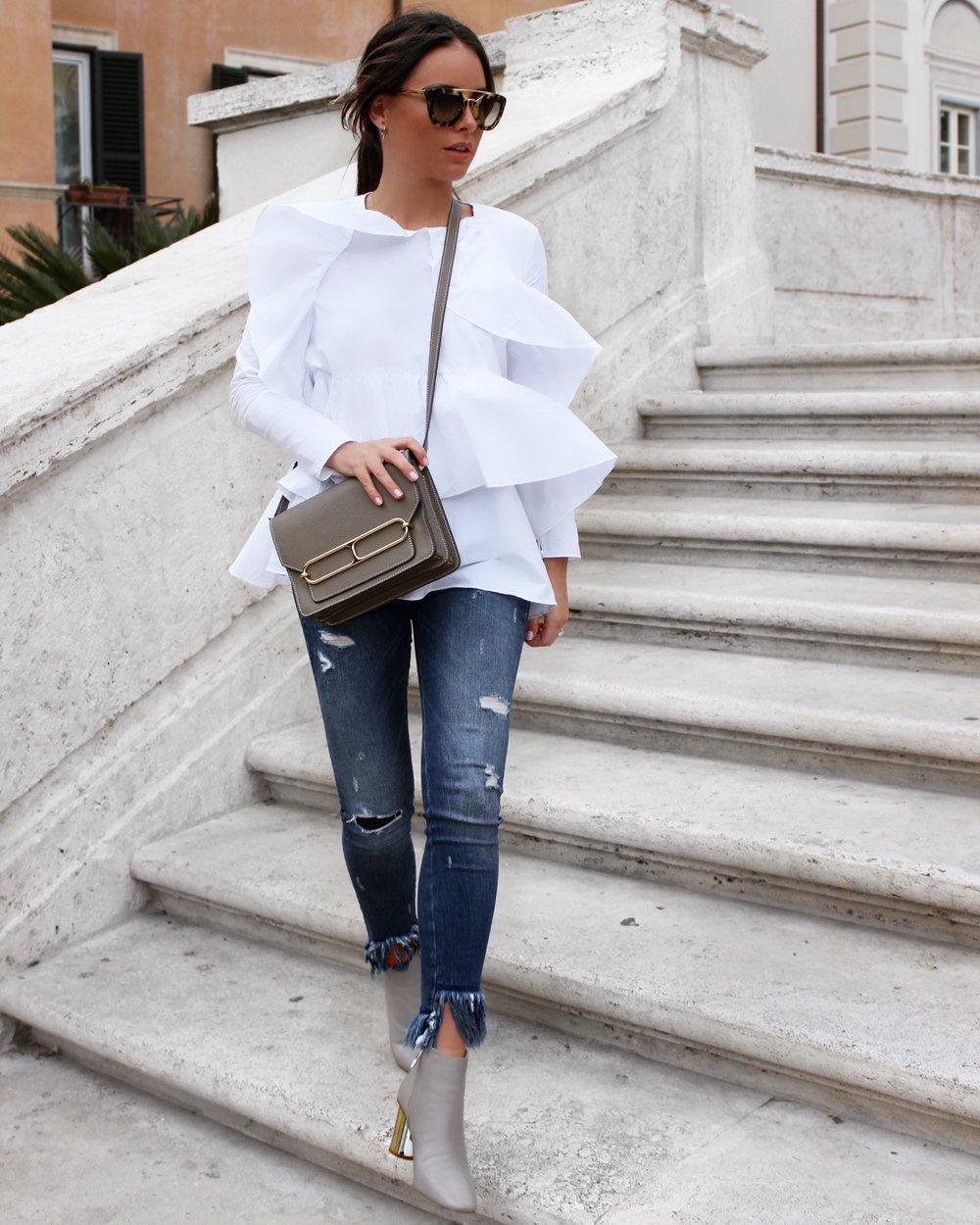 Zara Top here, Zara Jeans here, Zara Boots here, Prada Sunglasses here, Hermes Roulis Bag