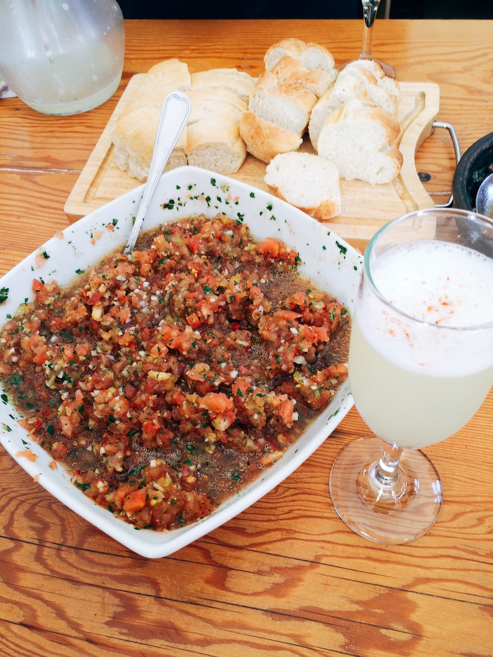 The perfect Chilean appetiser, fresh pebre, fresh bread and a freshly shaken pisco sour