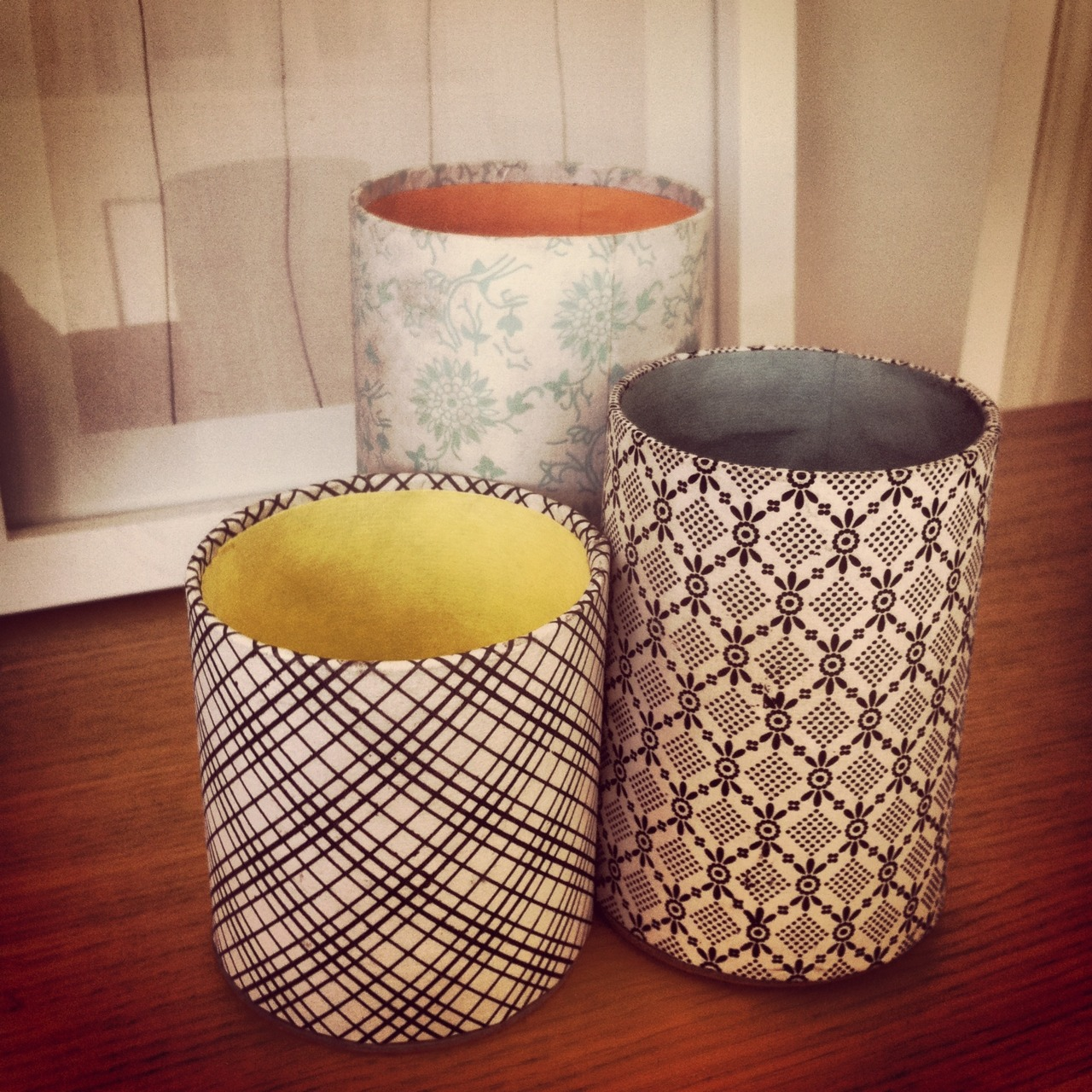 Don't these look lovely? They're from  Cox and Cox  and are made from cardboard covered with Japanese-influenced paper. A girl's gotta have a pretty desk…