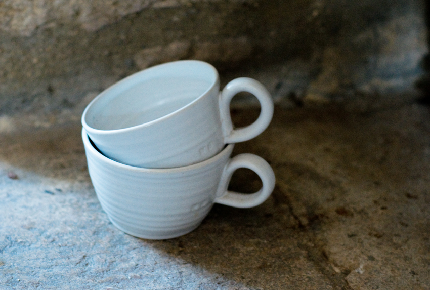 Two beautifully irregular handmade mugs I bought a couple of years back in St Ives