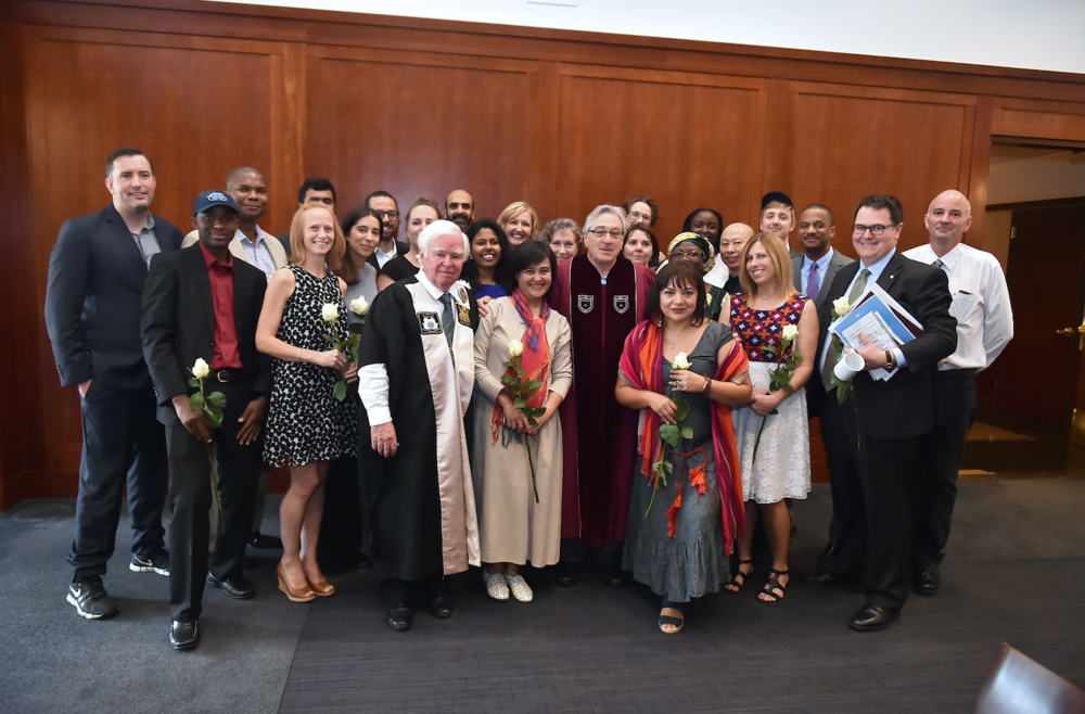 Robert De Niro poses with IDHA 50 graduates and CIHC President, Kevin M. Cahill, M.D.