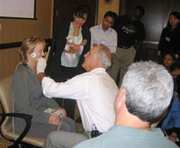 Dr. Reece demonstrating how to achieve a good dental bite at the seminar.