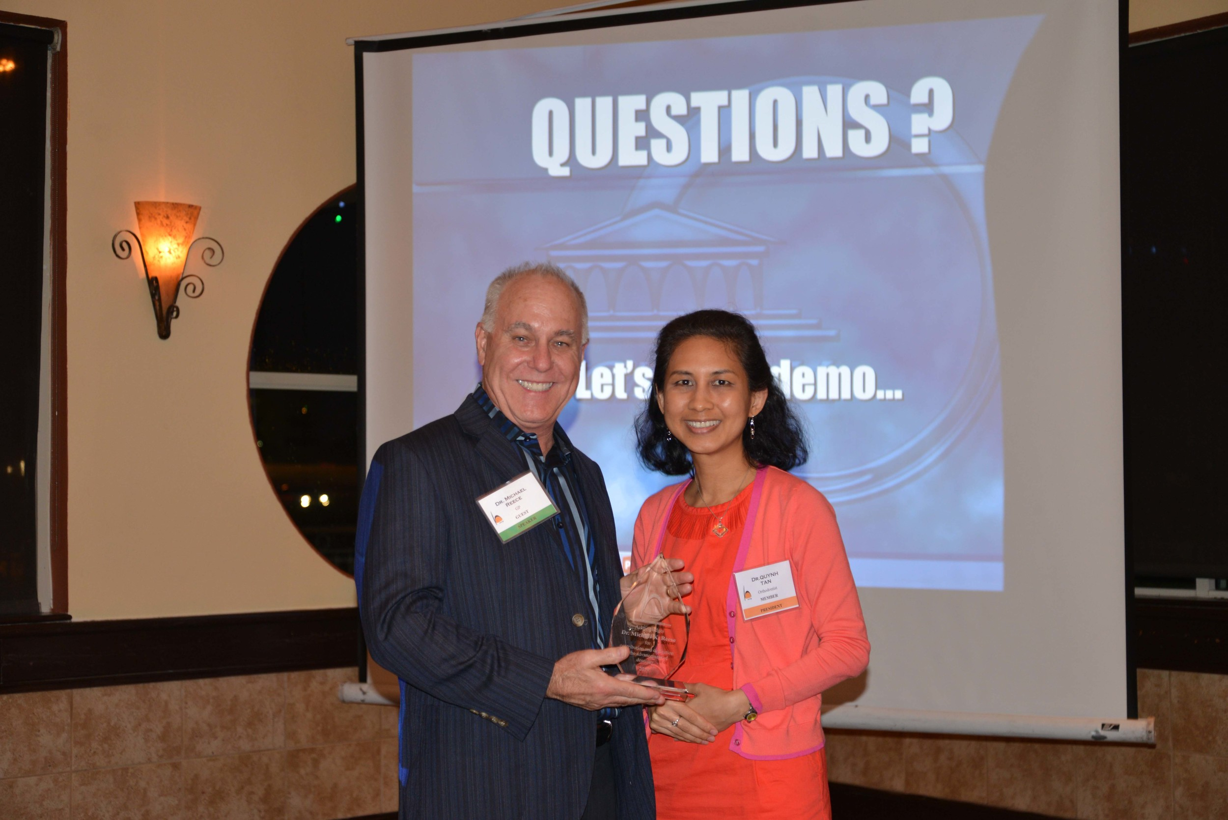 Dr. Reece is presented an award from the President of Houston Asian American Dental Society, Dr. Quynh Tan.