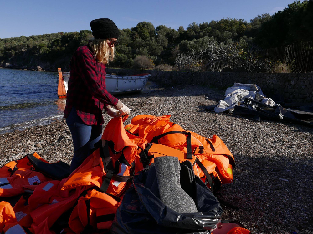 Aubrey Roemer deeconstructing life jackets at Skala Sikaminias, in Lesvos, Greece, 2015. Photo courtesy of Nermin Ismail.