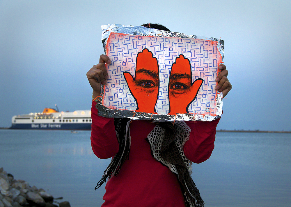 'Khamsa, Sadaqa Jaariyah (Endless Charity): The Refugee Crisis Portrait Project, Port of Lesvos', 2016. Photo courtesy of artist.