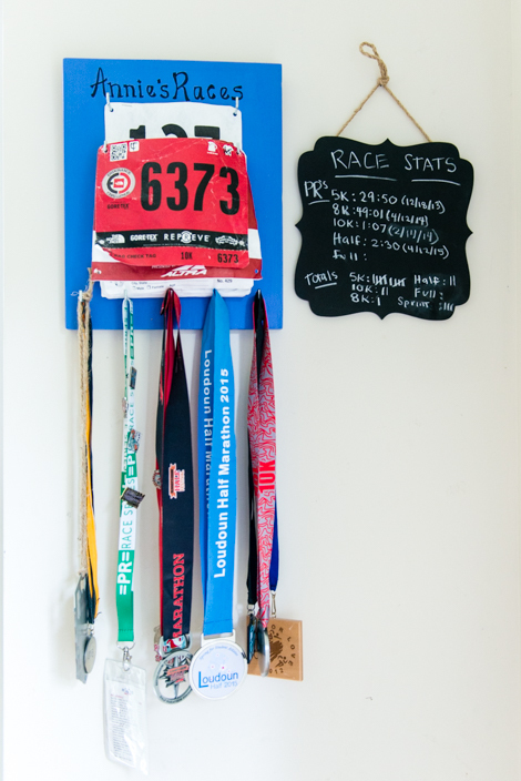 Competition medals and running stats hang in Powell's house. She says fitness and working as a personal trainer contributed to overcoming her depression after giving birth to the twins.  (HEIDI DE MARCO / KHN)