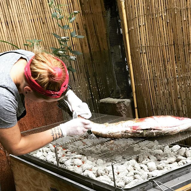 It's Restaurant Week!  Fresh NY Striped Bass on the menu with Sweet Corn, Watermelon and Delfino. Here's Chef @roxannespruance grilling one on the patio!⠀ .⠀ .⠀ .⠀ .⠀ .⠀ .⠀ .⠀ ⠀ #nycrestaurants #nycdining #nycfoodie #eeeeeats #foodie #feedfeed #f52grams #cheflife #foodporn #chefsofinstagram #truecooks #forkyeah #foodofig #foodiesofinstagram #nycfood #nyceats #foodandwine #nycrestaurantweek #stripedbass #summermenu #sweetcorn #grilling #restaurantweek #patio
