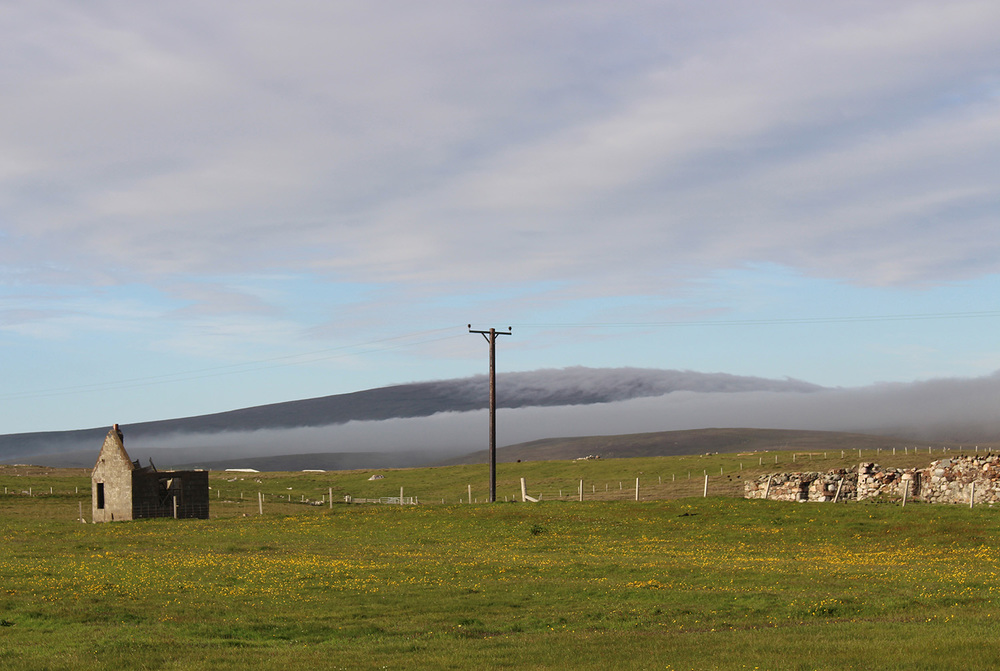 Dramatic contrast between the low cloud coming in and the dark heather of the hills beyond.
