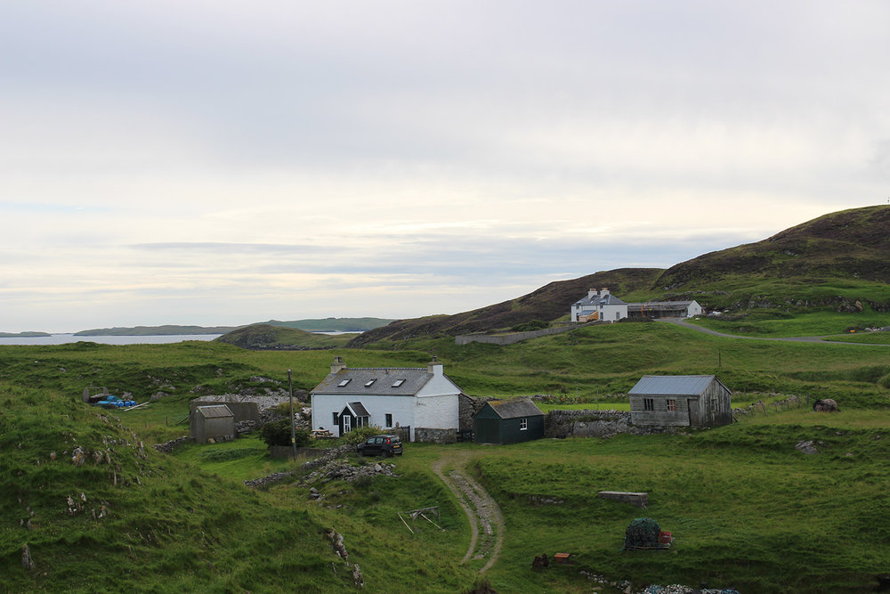 In between these two houses, although not visible in the photo, is the mouth of Stromness Voe.