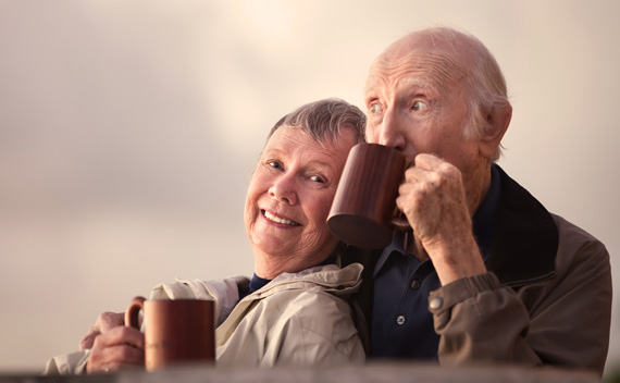 elderly-couple-outside-drinking-coffee.jpg