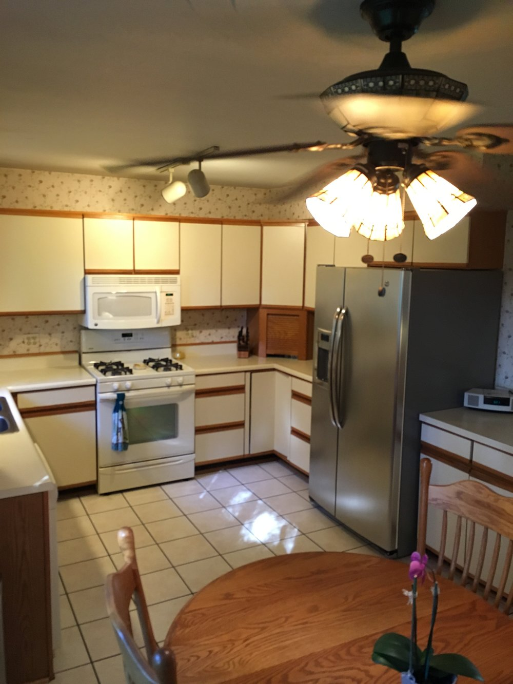 The size and placement of the appliances have this room feeling cramped.