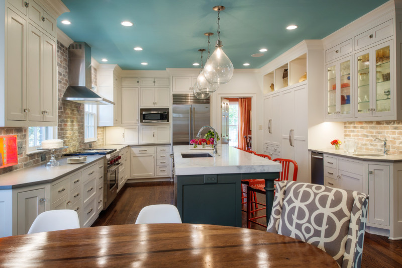 Renovated-kitchen-with-color-blue-ceiling-marble-island-orange-chairs.jpg