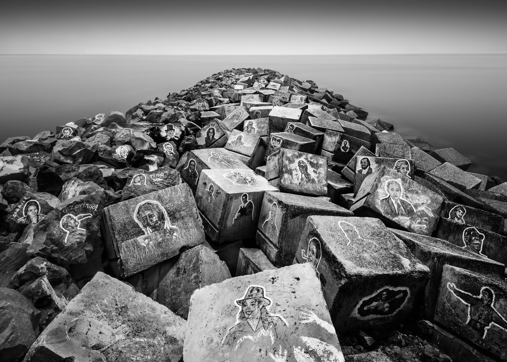 Musician Faces on Rocks