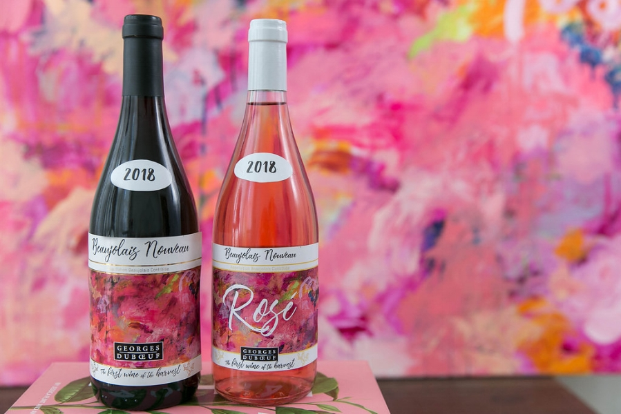"2018 Georges Duboeuf Beaujolais Nouveau featuring Chloé Meyer's painting ""Foolish Pleasure"" on the label. Photo cred: Tory Putnam"