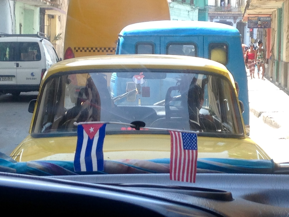 08.13.15 American and Cuban flags on car windshield in Havana