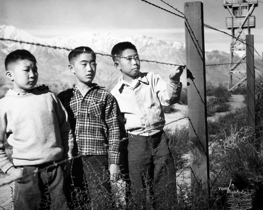 """Three Boys Behind Barbed Wire"" 1942-45 by Toyo Miyatake. Source:  UC Riverside"