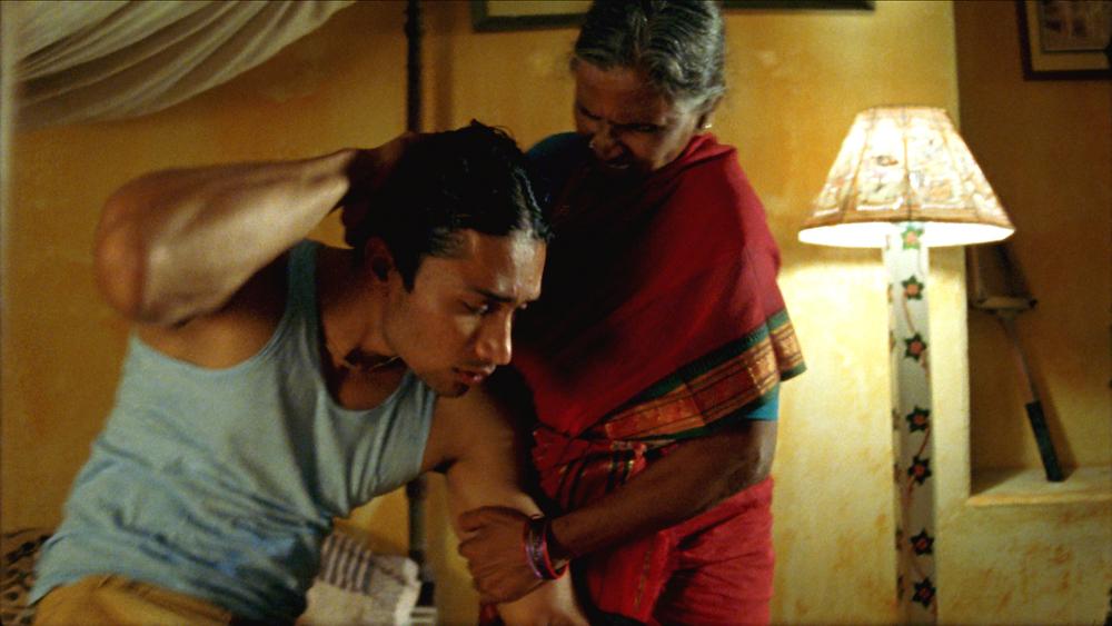 Rama Devi grabs Shekhar.jpg