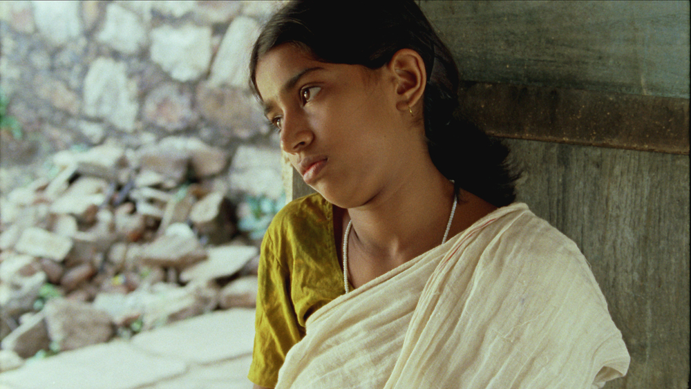 Vanaja looks loney after painting finger.jpg