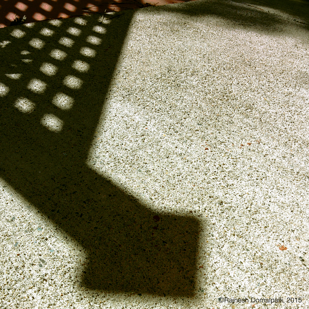 Shadow of Fencepost on Paving