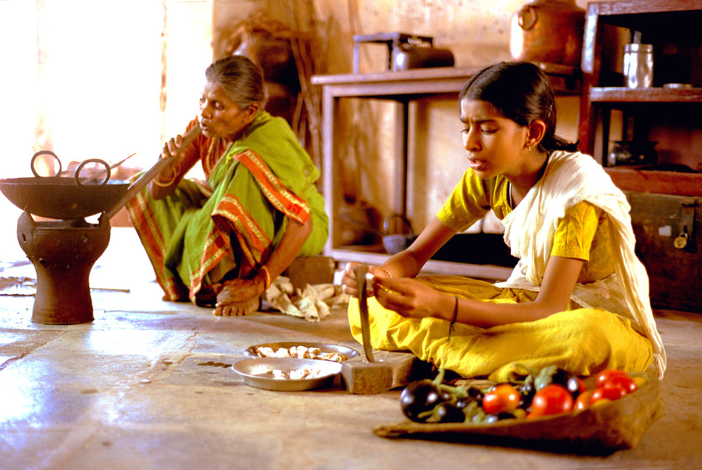 Vanaja and Radhamma, servants, in the landlady's kitchen.jpg