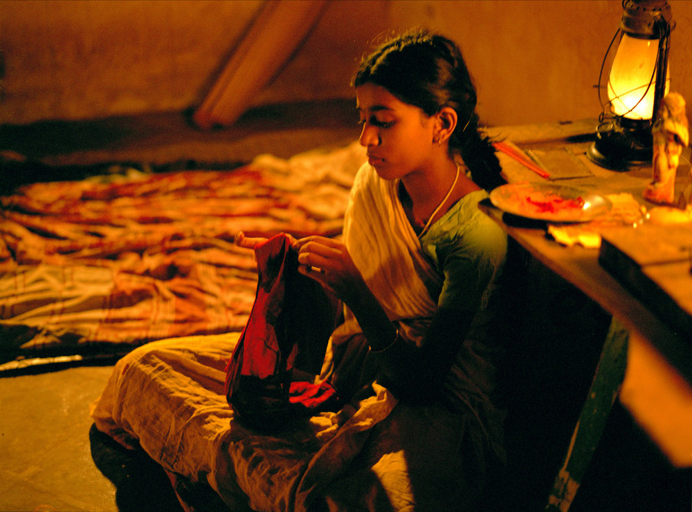 Vanaja Sewing by the light of a lantern.jpg