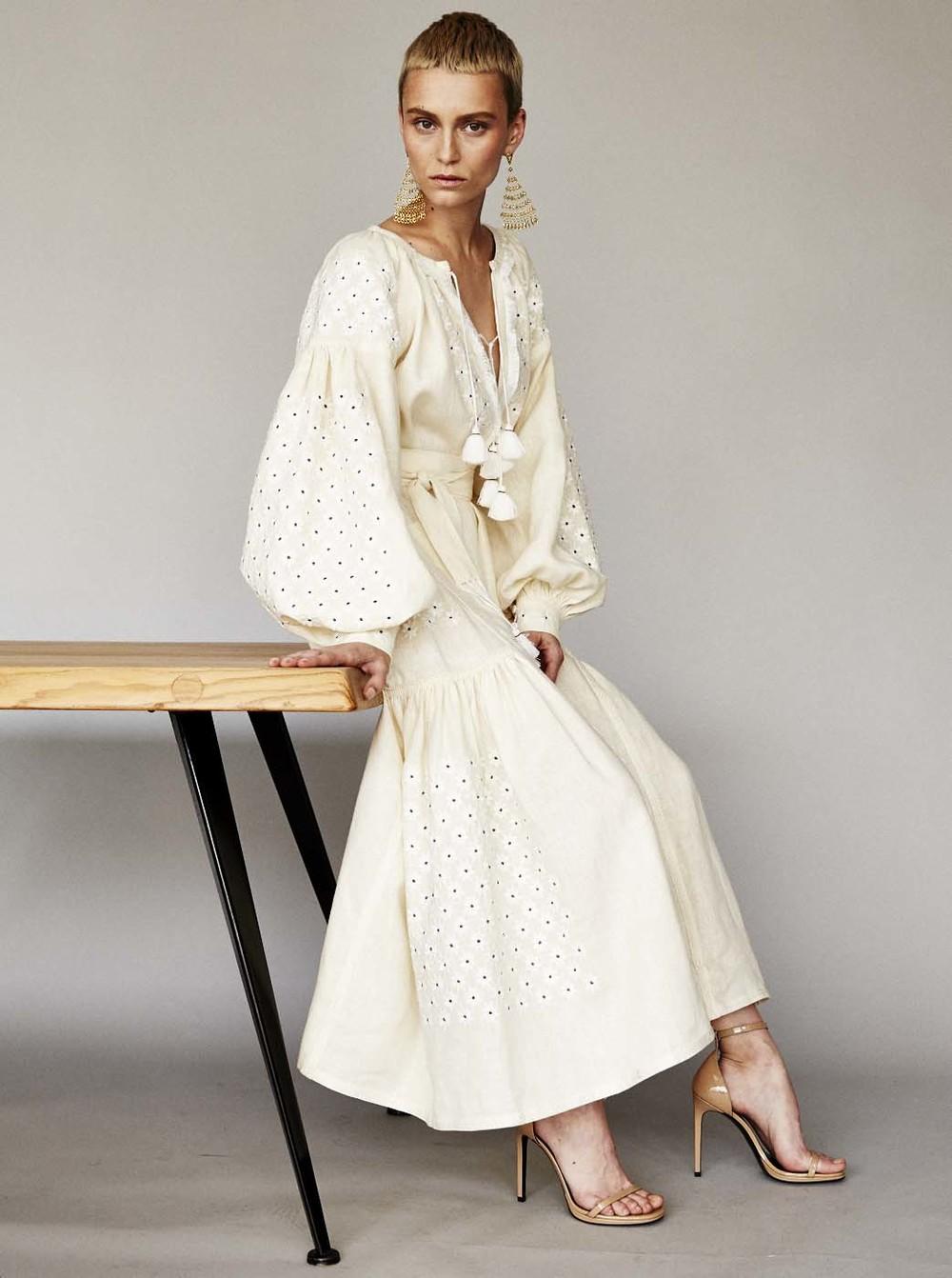 dress by vita kin, shoes by saint laurent, table by jean prouvé