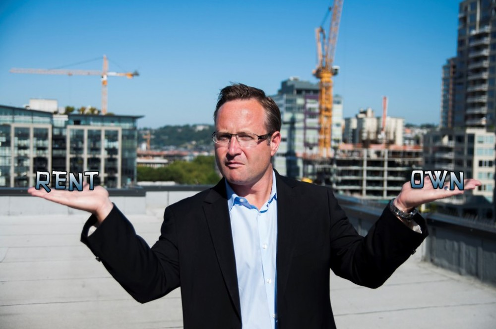 ABOVE: Dean Jones, President & CEO of Realogics Sotheby's International Realty, balances the cost of owning against the cost of renting similar homes in downtown Seattle.