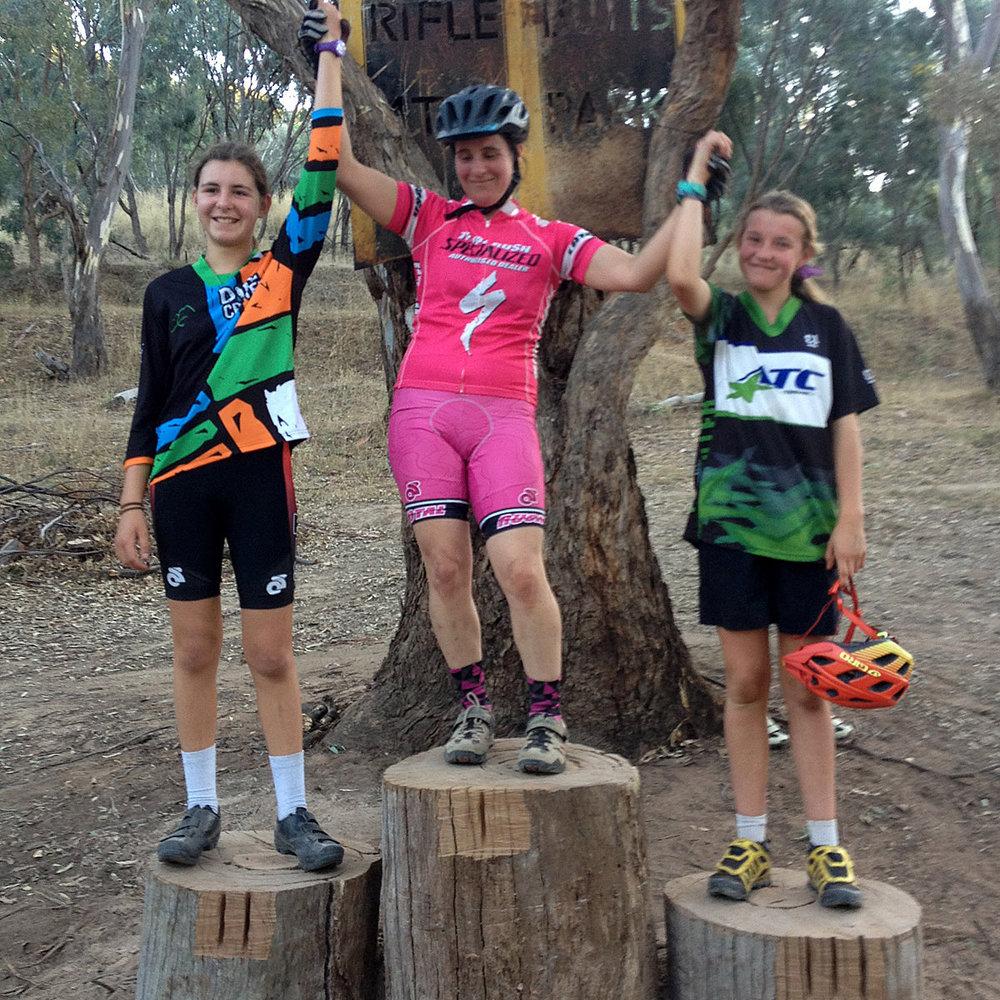 The Ladies' podium: 2. Bella Green; 1. Rachel Grundy; 3. Elise Empey.