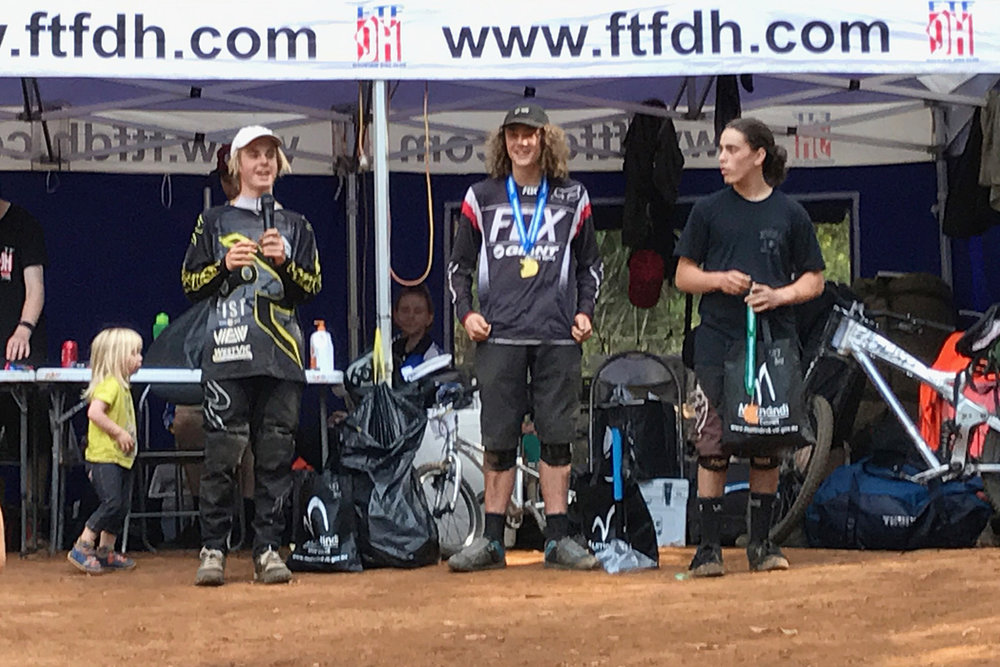 Charlie Jones, left, got second and Matt Empey, centre, took the win at Narbethong in the Under 17 class at the Victorian DH Series round 2.