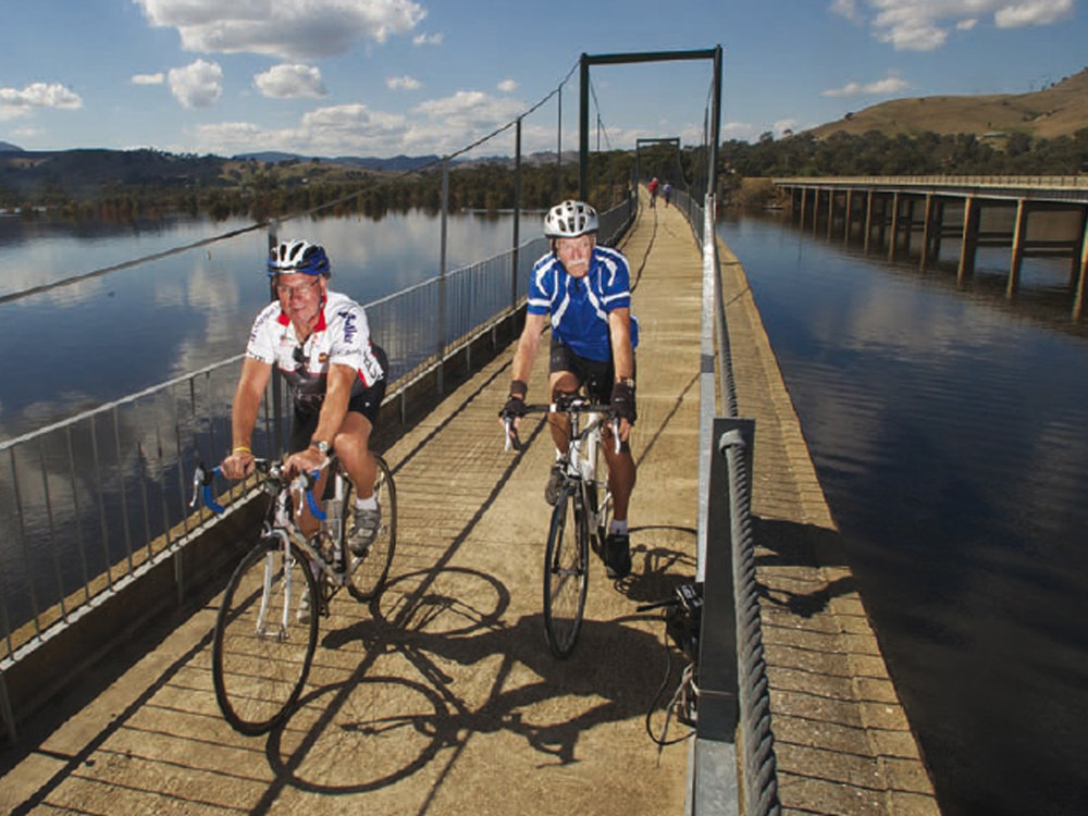 Ray Watson, on the right, riding across the Bonnie Doon bridge with his good mate George Chalk. This image is from a photoshoot organised by the Shire in 2011 to promote the rail trail.