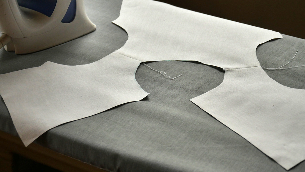 "Open your seams and press them flat.  This is what your shirt should look like from the ""right"" side."