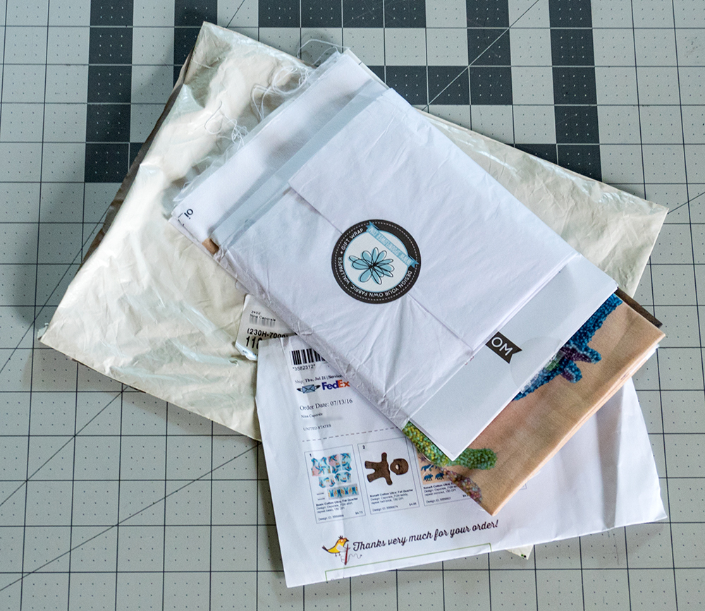 Inside the envelope, my purchases are wrapped in a sheet of tissue paper sealed with a sticker.  A packing slip includes full-color thumbnails of each of the prints in my order.
