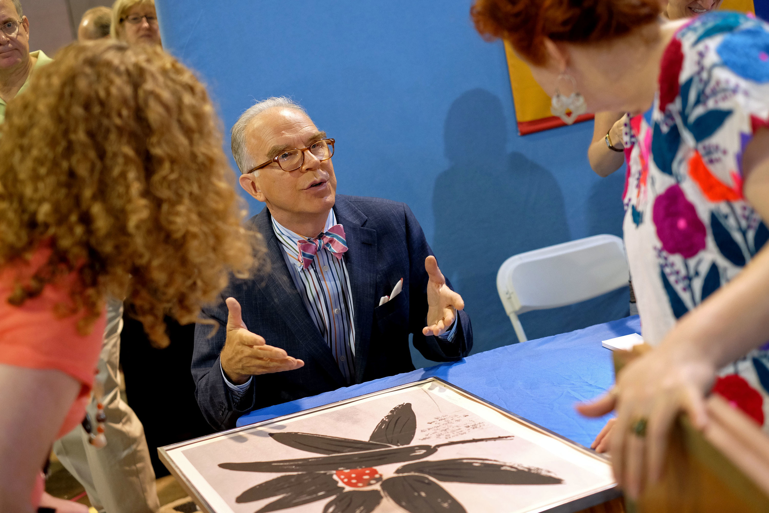 Asian Arts appraiser Lark Mason speaks with August, at left, and Alane, at right, about one of the prints they brought in to the Antiques Roadshow at the Albuquerque Convention Center, July 19, 2014, in Albuquerque NM. (Morgan Petroski/Journal)