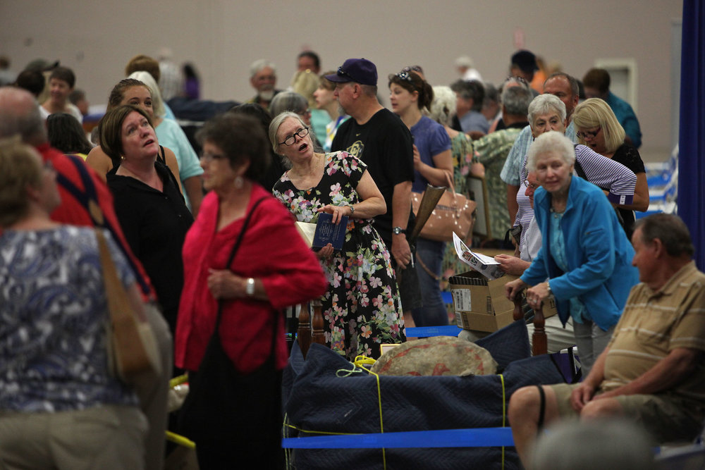 People wait in line at the Antiques Roadshow at the Albuquerque Convention Center, July 19, 2014, in Albuquerque NM. (Morgan Petroski/Journal)
